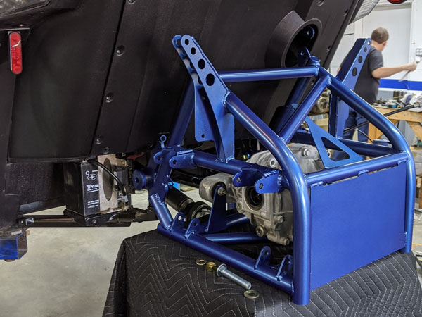 The Project 324 frame bolts directly to the Slingshot frame and shock mount location.